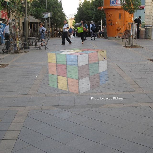 #3D chalk art of giant Rubik\'s cube in downtown #Jerusalem  Photo credit: Jacob Richman