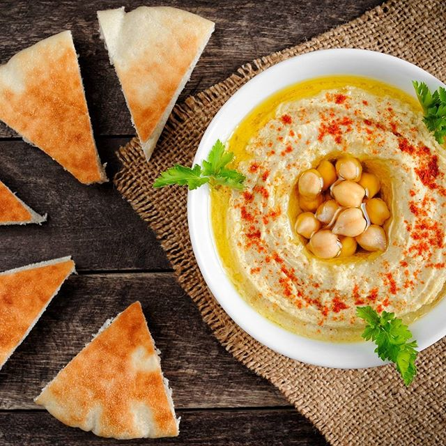 Fresh #homemade #hummus with chickpeas, olive oil, and parsley. Enjoy with pita bread! #delicious #IsraeliFood  Photo credit: Kert