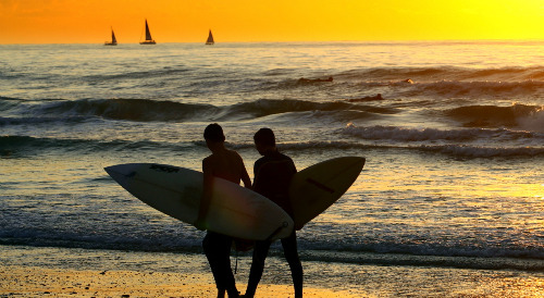 Surfers enjoy Mediterranean sunset