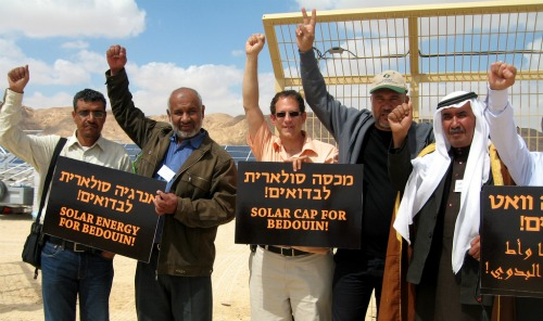 Arava Power's Yosef Abramowitz, center, with Bedouins