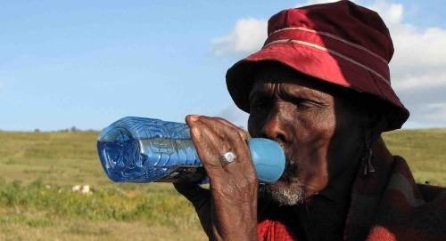 Man using water device in Tanzania