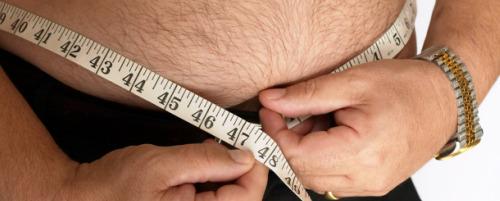Overweight-Man-Measuring-Waist