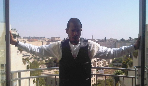 Shyne on balcony overlooking Jerusalem's Old City