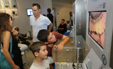 Visitors watch how the PillCam shows doctors what's going on in the gut. Photo courtesy of Bloomfield Science Museum